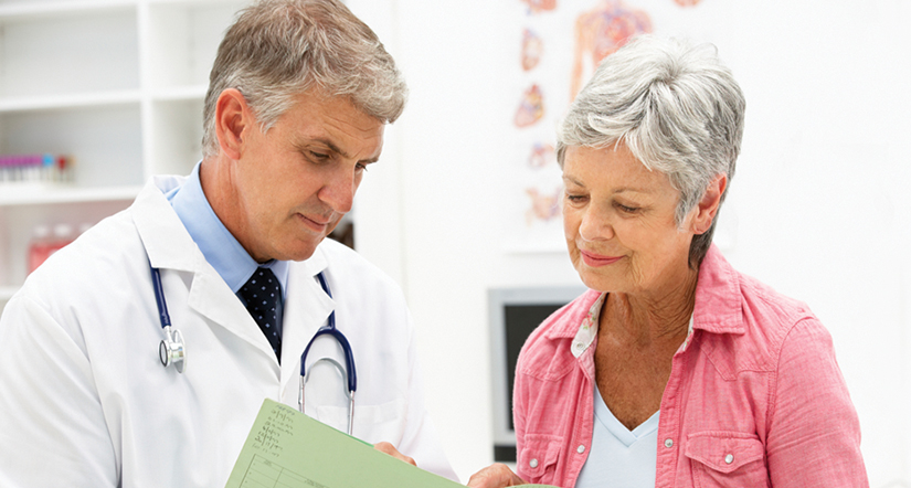 Male doctor discussing results with senior female patient